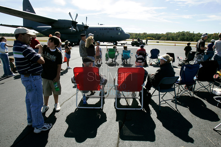 People sit and wander around a C-130 aircraft at The Great Georgia Airshow at Falcon Field Airport in Peachtree City, Ga. on Sunday, Oct. 15, 2006.<br />