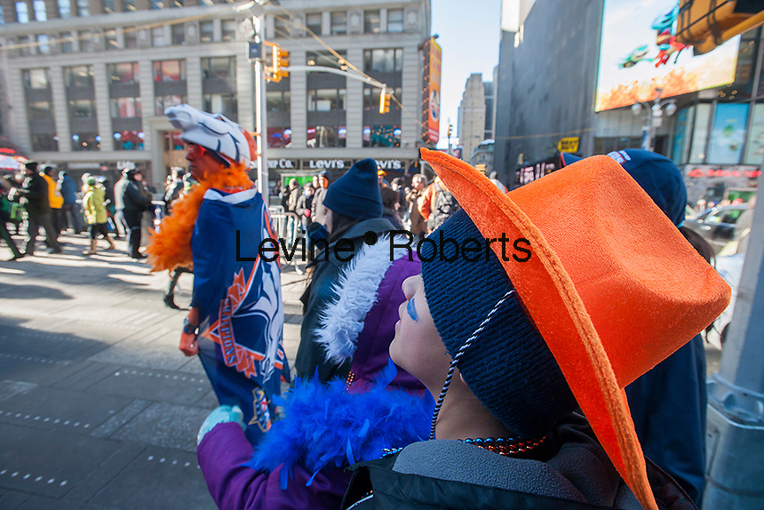A family of visitors dressed up in Denver Broncos outfits on opening day of Super Bowl Boulevard in Midtown Manhattan in New York on Wednesday, January 29, 2014. Despite the game being held in New Jersey on February 2 sports fans are expected to pack New York to take part in the multitude of activities planned around the game including the 13 block stretch of Broadway, running from 34th street through 47th street that will host Super Bowl Blvd. from January 29 to February 1. (© Richard B. Levine)