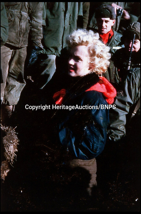 BNPS.co.uk (01202) 558833<br /> Picture: HeritageAuctions<br /> <br /> **please use full bylline**<br /> <br /> A set of four colour slides show Monroe mingling and laughing with troops and signing autographs.<br /> <br /> Never-seen-before photos and footage of Marilyn Monroe wooing soldiers in the aftermath of the Korean War have emerged for sale. The whirlwind tour saw the star perform 10 shows over four days to more than 100,000 soldiers and marines who were celebrating the end of three years of combat in 1954. The rare images were bought by a collector in the 1990s direct from the military photographer and have never been published.