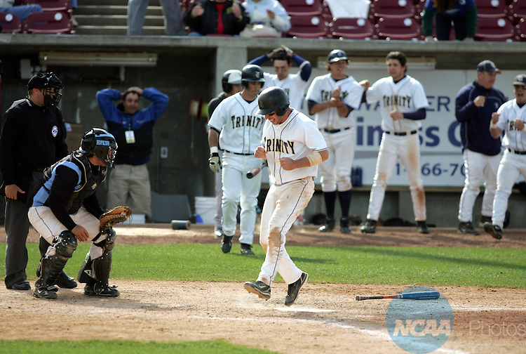 27 MAY 2008:  Trinity College base runner Kent Graham scores the tying run as batter Matt Sullivan draws a walk with the bases loaded in the bottom of the ninth inning during the Division III Men's Baseball Championship game held at Fox Cities Stadium in Grand Chute, WI.  Trinity defeated Johns Hopkins 5-4 to win the national championship after losing the first game of a double elimination 4-3 and ending a 44 game winning streak.  Allen Fredrickson/NCAA Photos