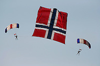 Two parachuters with large Norwegian flag between them. Norway