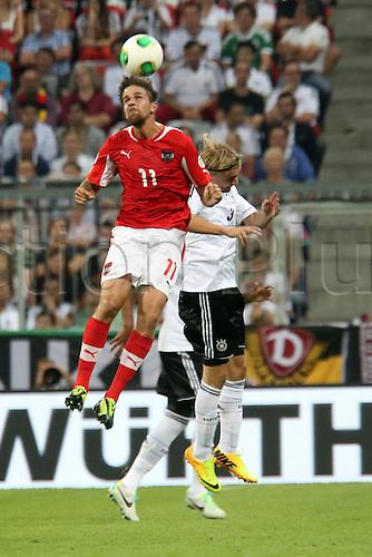 06.09.2013. Allianz Arena, Munich, Germany.  Martin Harnik AUT against Marcel Schmelzer Germany versus Austria  World Cup Qualification Munich