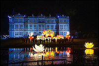 BNPS.co.uk (01202 558833)<br /> Pic: DavidMcGirr/BNPS<br /> <br /> ***Please Use Full Byline***<br /> <br /> Illuminated elephants and lotus flowers in front of Longleat House.<br /> <br /> The largest Chinese 'Festival of Light' seen in Europe is taking shape at the Longleat House in Wiltshire - A small army of over 50 skillled workers have flown in from the remote village of Zigong in central China to create the stunning spectacle.<br /> <br /> Among the different scenes are a 20-metre tall Chinese temple, a 70-metre-long dragon, created using more than 10,000 porcelain cups, bowls, plates and dishes, and the mythical qilin &ndash; a chimerical hooved creature with the head of a lion &ndash; featuring more than 30,000 glass phials filled with coloured liquid.<br /> <br /> Massive traditional Chinese masks are also featured and there is also a bamboo forest which is home to a family of life-size pandas, giant elephants, zebras, lions and deer as well as giant lotus flowers floating on the lake.<br /> <br /> Filled with thousands of LED lights and handmade by a team of 50 highly-skilled craftsmen from Zigong in China's Sichuan province, the lanterns recreate a magical world of myths and legends.<br /> <br /> Set amid the beautiful backdrop of the landscaped grounds and gardens surrounding Longleat House, the lit structures also spill out on to Half Mile Lake to create a stunning and enchanting experience for visitors.<br /> <br /> It&rsquo;s the first time a festival of this size has taken place in the UK and the Chinese team behind the spectacular event believe its size and complexity make it unique throughout Europe.