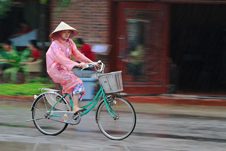 Woman Cyclist in the rain