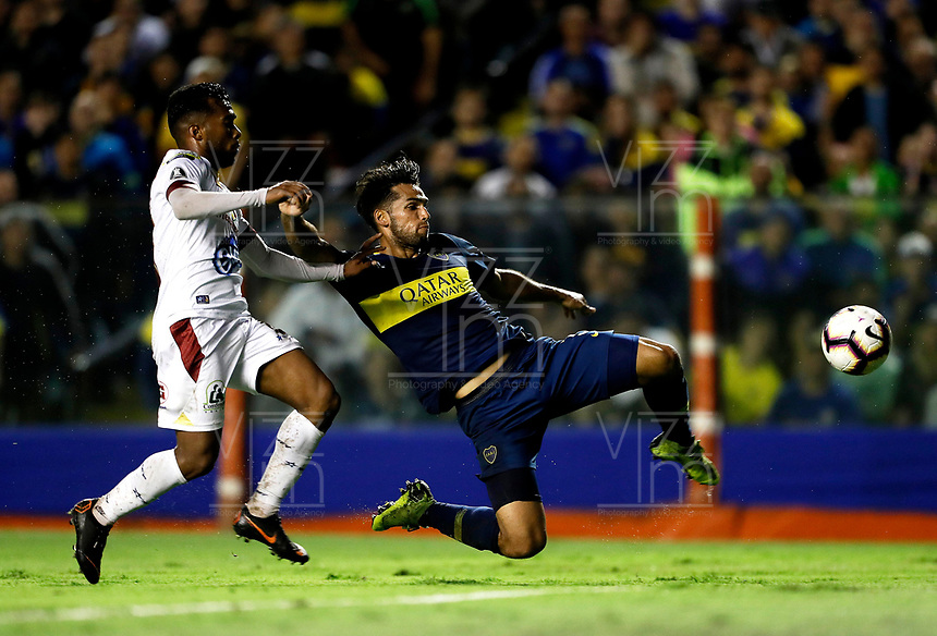 "BUENOS AIRES-ARGENTINA, 12-03- 2019: Emmanuel Mas de Boca Juniors (ARG) disputa el balón con Juan Vargas de Deportes Tolima (COL), durante partido de la fase de grupos, grupo G, fecha 2, entre Boca Juniors (ARG) y Deportes Tolima (COL), por la Copa Conmebol Libertadores 2019, en el estadio Alberto J. Armando ""La Bombonera"", de la ciudad Ciudad Autónoma de Buenos Aires. / Emmanuel Mas of Boca Juniors (ARG) vies for the ball with Juan Vargas of Deportes Tolima (COL), during a match of the groups phase, group G, 2nd date, beween Boca Juniors (ARG) and  Deportes Tolima (COL), for the Conmebol Libertadores Cup 2018, at the Alberto J. Armando ""La Bombonera"" Stadium, in Ciudad Autonoma de Buenos Aires. VizzorImage / Javier García Martino / Photogamma / Cont."
