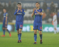 Bolton Wanderers' Pawel Olkowski (right) and Luke Murphy applaud the fans at full time<br /> <br /> Photographer Kevin Barnes/CameraSport<br /> <br /> The EFL Sky Bet Championship - Swansea City v Bolton Wanderers - Saturday 2nd March 2019 - Liberty Stadium - Swansea<br /> <br /> World Copyright © 2019 CameraSport. All rights reserved. 43 Linden Ave. Countesthorpe. Leicester. England. LE8 5PG - Tel: +44 (0) 116 277 4147 - admin@camerasport.com - www.camerasport.com