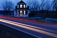 Wagons lined up 20 deep at Searights Tollhouse, one of six built in Pennsylvania when the U.S. turned the road--and its expense--over to the state in the mid-1830s. Designed by the Army Corps of Engineers, the buildings resemble lighthouses. Traffic streams the historic building at dusk.