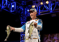 NWA Democrat-Gazette/BEN GOFF -- 04/25/15 Andy Morgan, FLW Pro from Dayton, Tenn., displays his two best bass during weigh-in on day three of the Walmart FLW Tour at Beaver Lake on Saturday Apr. 25, 2015 at the John Q. Hammons Center in Rogers. Morgan maintained his lead with a three-day total weight of 39 lbs. 2 oz.