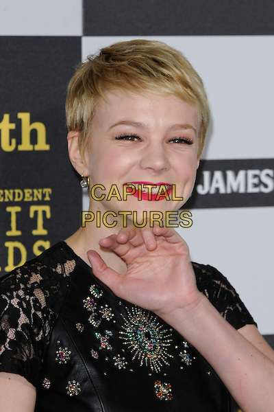 CAREY MULLIGAN.The 25th Annual Film Independent Spirit Awards at the LA Live Event Deck in Los Angeles, California, USA..March 5th, 2010  .headshot portrait smiling pink red lipstick  black leather pattern beads beaded lace hand palm waving .CAP/ROT.©Lee Roth/Capital Pictures