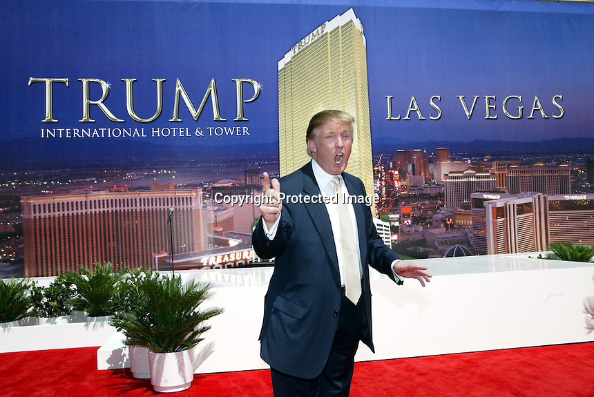 7/12/05,Las Vegas,Nevada --- Real estate mogul  Donald Trump poses during a groundbreaking ceremony for his Trump International Hotel & Tower Las Vegas , a 64-story tower featuring 1,282 luxurious condominium hotel units that will be built on a portion of the New Frontier property on the Las Vegas Strip. --- Chris Farina