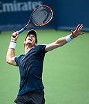 Andy Murray (GBR) edged out John Isner (USA) in a tight three set match at the Western & Southern Open by 67(3) 64 76(2) in Mason, OH on August 14, 2014.
