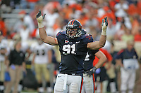 UVa football lineman Chris Long for the Virginia Cavaliers playing in Scott Stadium at the University of Virginia in Charlottesville, VA. Photo/Andrew Shurtleff.