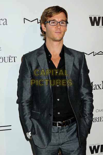 RYAN KWANTEN .3rd Annual Women In Film Pre-Oscar Party held at a Private Residence in Beverly Hills, California, USA, .4th March 2010..half length shirt suit jacket hands in pockets belt glasses black grey gray .CAP/ADM/BP.©Byron Purvis/AdMedia/Capital Pictures.
