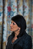 Governor Nikki Haley (Republican of South Carolina) listens to United States President Barack Obama speak to the National Governors Association in the State Dining Room of the White House in Washington, DC, USA, 24 February 2014. The governors are in DC for their winter meeting.<br /> Credit: Jim LoScalzo / Pool via CNP