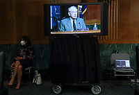 United States Senator Chuck Grassley (Republican of Iowa), Chairman, US Senate Committee on Finance is seen on a television monitor as he presides during a hearing on the role of unemployment insurance during the coronavirus disease (COVID-19) pandemic on Capitol Hill in Washington, U.S., June 9, 2020. <br /> Credit: Leah Millis / Pool via CNP/AdMedia