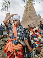 Soleman Ndara Pico posed for photograph as he straighten his kapota (Sumbanese traditional headdress) in front of his house at the village of Wainyapu. Famous for his agility and accuracy on the horseback, he is considered as one of the most feared Pasola warrior around Kodi region of Southwestern Sumba.