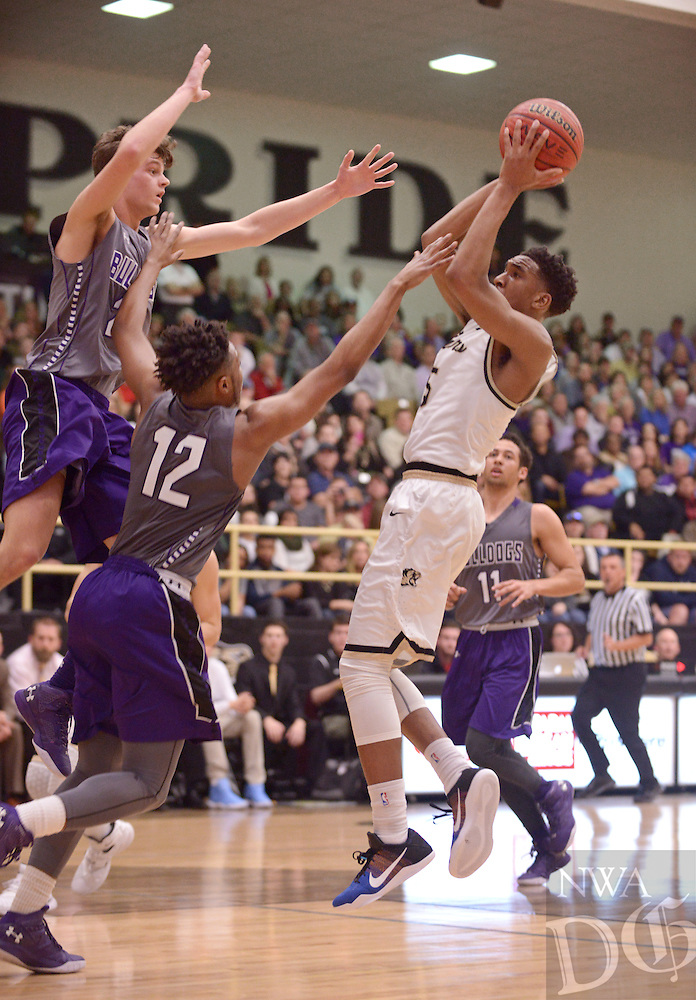NWA Democrat-Gazette/BEN GOFF @NWABENGOFF<br /> Malik Monk of Bentonville shoots as August Carlson and DeMaunte Youngblood (12) of Fayetteville defend on Friday Feb. 26, 2016 during the game in Bentonville's Tiger Arena.