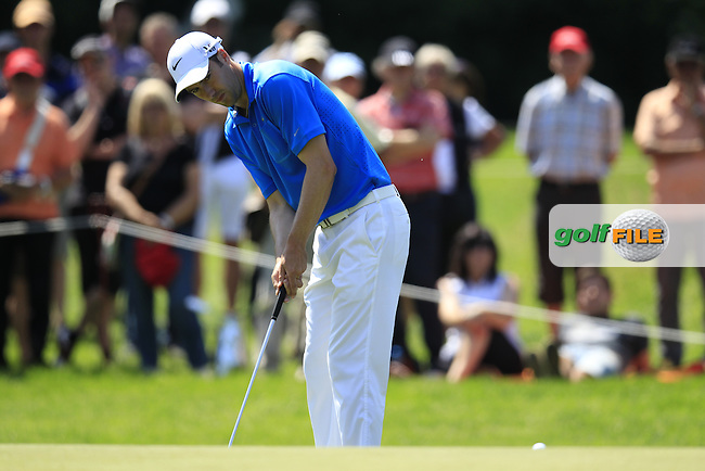 Ross Fisher (ENG) putts on the 8th green during Friday's Round 2 of the 2013 BMW International Open held on the Eichenried Golf Club, Munich, Germany. 21st June 2013<br /> (Picture: Eoin Clarke www.golffile.ie)