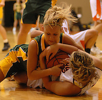 Howell senior Kerri Yarber, top, struggles with Brighton senior Chelsea Albert for possession during the first quarter at Brighton High School on Thursday, October 5, 2006. Brighton coach Jason Piepho led the team to victory over Howell, which is coached by his father, Lee Piepho.
