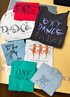 Photos, t-shirts, programs and tickets from the Special Collections in the Library of one of Occidental College's oldest traditions, Dance Production, or Dance Pro.<br /> (Photo by Marc Campos, Occidental College Photographer)