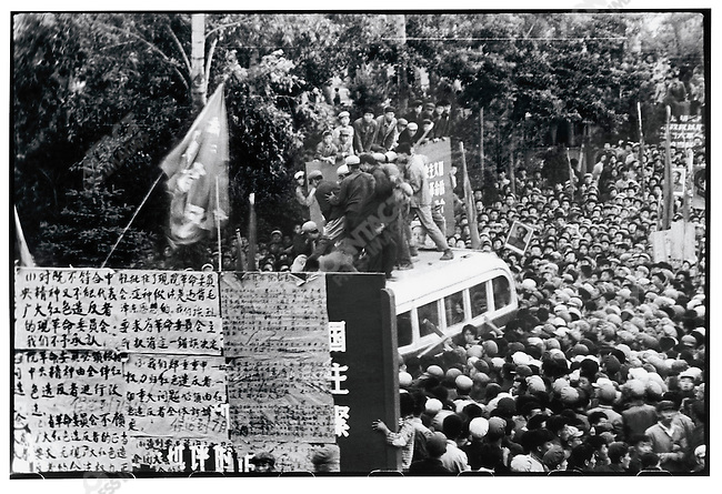 Two rebel factions fight for control of a broadcasting bus in front of the Heilongjiang revolutionary committee headquarters. Harbin, 5 June 1967
