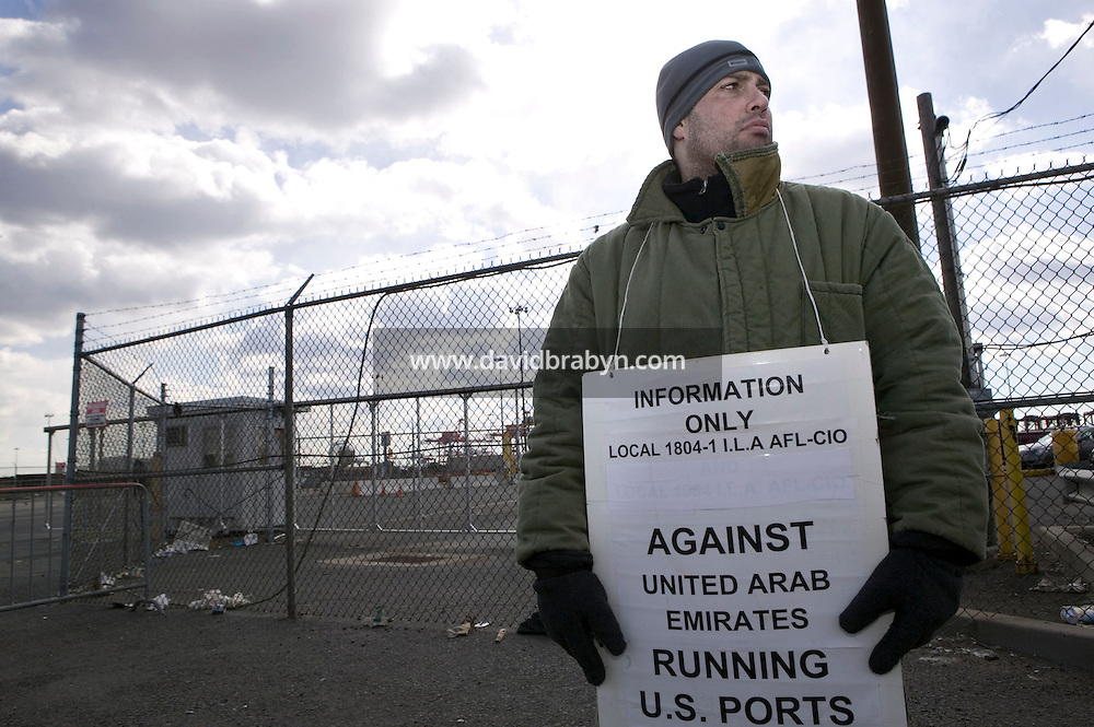24 February 2006 - Newark, NJ - Carlo Commesso, a member of the Longshoremen's Local 1804-1 union, protests outside the Port of Newark Container Terminal in Newark, USA, against the planned transfer of the management of certain US ports to a United Arab Emirates company, 24 February 2006.