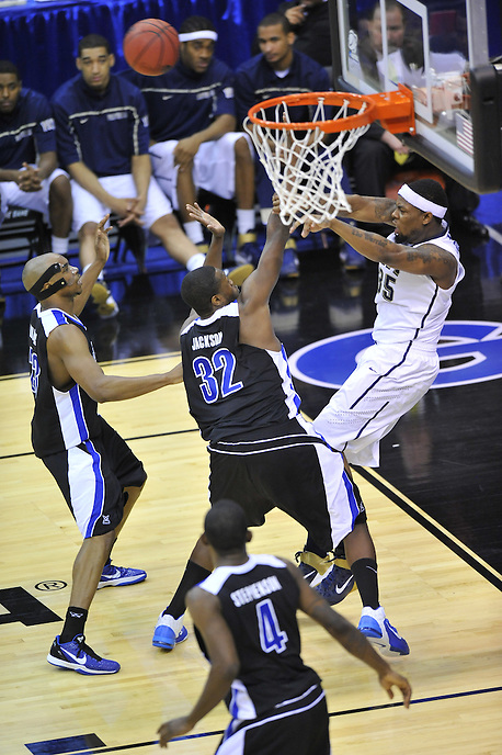 Nasir Robinson of the Panthers is trapped underneath the basket and passes the ball to a teammate. Pittsburgh defeated UNC-Asheville 74-51 during the NCAA tournament at the Verizon Center in Washington, D.C. on Thursday, March 17, 2011. Alan P. Santos/DC Sports Box