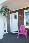 Front porch with Flowers and Chair