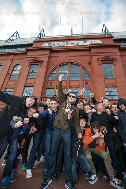 Rangers fans (TBO/UB) celebrate winning the third division title outside Ibrox tonight