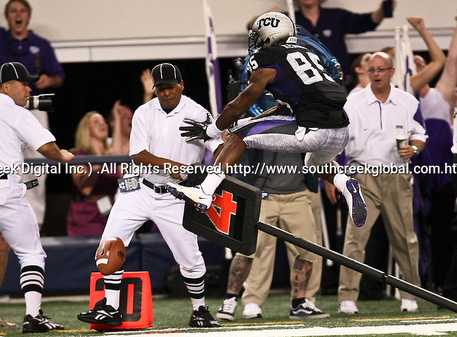 TCU Horned Frogs wide receiver Jeremy Kerley #85 runs into a official during the game between the Oregon State Beavers and the TCU Horned Frogs at the Cowboy Stadium in Arlington,Texas. TCU defeated Oregon State 30-21.