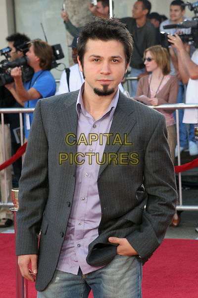 """FREDDY RODRIGUEZ.Los Angeles Premiere of """"Dreamer"""" held at the Mann Village Theater.9th October 2005.Ref:ADM/ZL.three quarter length grey pinstripe suit jacket violet purple shirt jeans goatee beard hands in pocket.sales@capitalpictures.com.©Zach Lipp/AdMedia/Capital Pictures."""
