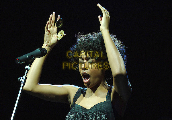 CORINNE BAILEY RAE.Performing live at the 2007 V Festival, Hylands Park, Chelmsford, England..August 19th, 2007.half length stage concert live gig performance music black singing microphone hands arms in air cymbals.CAP/BEL.©Belcher/Capital Pictures