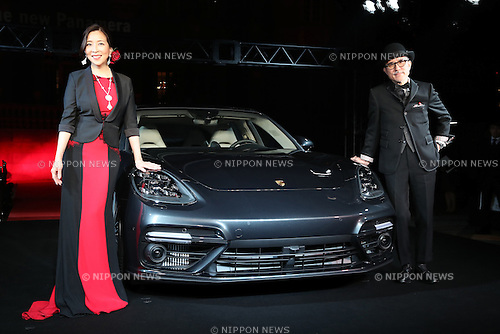 December 20, 2016, Tokyo, Japan - Japanese actress Miki Maya (L) and Yukihiro Takahashi, a member of the Yeloow Magic Orchestra (YMO) display the new Panamera of German sports car maker Porsche in Tokyo on Tuesday, December 20, 2016. Porsche's four-door sedan Panamera has a 550-horse power 4.0-litter turbo charged engine to drive all wheels.  (Photo by Yoshio Tsunoda/AFLO) LWX -ytd-
