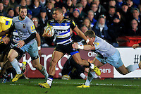 Jonathan Joseph of Bath Rugby takes on the Northampton Saints defence. Aviva Premiership match, between Bath Rugby and Northampton Saints on December 5, 2015 at the Recreation Ground in Bath, England. Photo by: Patrick Khachfe / Onside Images