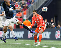 Foxborough, Massachusetts - March 24, 2019: First half action. In a Major League Soccer (MLS) match, New England Revolution (blue/white) vs FC Cincinnati (white), at Gillette Stadium.