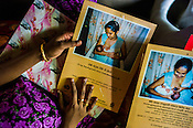 An expecting woman is shown pamphlets on breast feeding during a field visit in Punaineeravi village in Kilinochchi in Northern Sri Lanka. Photo: Sanjit Das/Panos