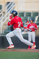 Daniel Brito (21) of the Lakewood BlueClaws follows through on his swing against the Kannapolis Intimidators at Kannapolis Intimidators Stadium on April 6, 2017 in Kannapolis, North Carolina.  The BlueClaws defeated the Intimidators 7-5.  (Brian Westerholt/Four Seam Images)