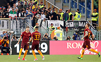 Calcio, Serie A: Roma vs Juventus. Roma, stadio Olimpico, 14 maggio 2017. <br /> Roma's Stephan El Shaarawy, left, celebrates with teammates Emerson Palmieri, center, and Daniele De Rossi after scoring during the Italian Serie A football match between Roma and Juventus at Rome's Olympic stadium, 14 May 2017. Roma won 3-1.<br /> UPDATE IMAGES PRESS/Riccardo De Luca