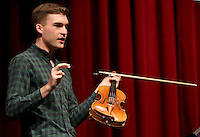 NWA Democrat-Gazette/DAVID GOTTSCHALK  Violinist Alexi Kenney speaks between performing Thursday, March 2, 2017, to a group of fine arts students at the new Farmington High School Performing Arts Center. Kenney's engagement is part of the Symphony of Northwest Arkansas's education outreach commitment. Kenney is performing with SONA as part of their Masterworks concerts series this weekend.