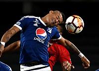 BOGOTA - COLOMBIA – 17 - 04 - 2018: Ayron del Valle (Der.) jugador de Millonarios (COL), salta por el balon con Daniel Carrillo (Izq.) jugador de Deportivo Lara (VEN), durante partido entre Millonarios (COL) y Deportivo Lara (VEN), durante partido entre Millonarios (COL) y Deportivo Lara (VEN), de la fase de grupos, grupo G, fecha 3 de la Copa Conmebol Libertadores 2018, en el estadio Nemesio Camacho El Campin, de la ciudad de Bogota. / Ayron del Valle (R) player of Millonarios (COL), jumps for the ball with Daniel Carrillo (L) player of Deportivo Lara (VEN), during a match between Millonarios (COL) and Deportivo Lara (VEN), of the group stage, group G, 3rd date for the Conmebol Copa Libertadores 2018 in the Nemesio Camacho El Campin stadium in Bogota city. VizzorImage / Luis Ramirez / Staff.