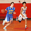 Kyle DeVerna #22 of Kellenberg, left, looks to stay ahead of Joe Bourne #3 of Long Beach during a non-league varsity boys' basketball game at Freeport High School on Monday, Jan. 18, 2016. DeVerna scored a game-high 30 points in Kellenberg's 71-62 win.