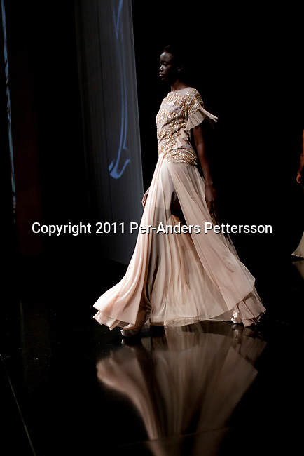 CAPE TOWN, SOUTH AFRICA - JULY 14: Sudanese model Akuol de Mabior shows a dress for the Cape Town based designer Gavin Rajah a fashion show at the the Cape Town Fashion Week on July 14, 2011, in Cape Town, South Africa. Some of South Africa's finest designers showed their 2011 Spring and summer collections during the 3 day event. Photo by Per-Anders Pettersson