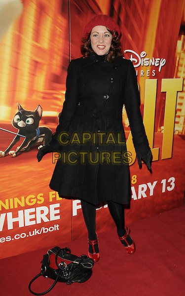 "SARAH CAWOOD .The ""Bolt"" VIP screening, Cineworld cinemas, Haymarket, London, England..February 1st, 2009.full length black coat jacket red hat sara bag purse shoes.CAP/CAN.©Can Nguyen/Capital Pictures."