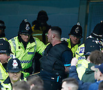 Police make an arrest during the Barclays Premier League match at The Etihad Stadium. Photo credit should read: Simon Bellis/Sportimage