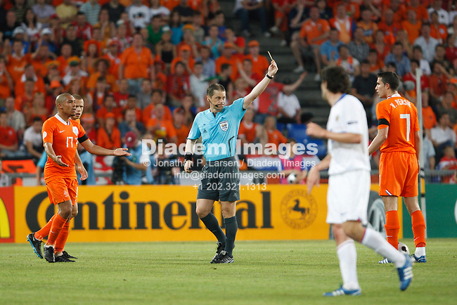 BASEL, SWITZERLAND - JUNE 21:  Referee Lubos Michel books the Netherlands' Robin van Persie during a UEFA Euro 2008 quarterfinal match at St. Jakob Park June 21, 2008 in Basel, Switzerland.  (Photograph by Jonathan P. Larsen)