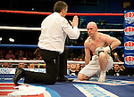 GLASGOW, SCOTLAND - MARCH 10: Tommy Tolan (white shorts) being counted out in his bout with Callum Johnson during their Light-Heavyweight contest on the Ricky Burns undercard at the Braehead Arena on March 10, 2012 in Glasgow, Scotland. (Photo by Rob Casey/Getty Images)