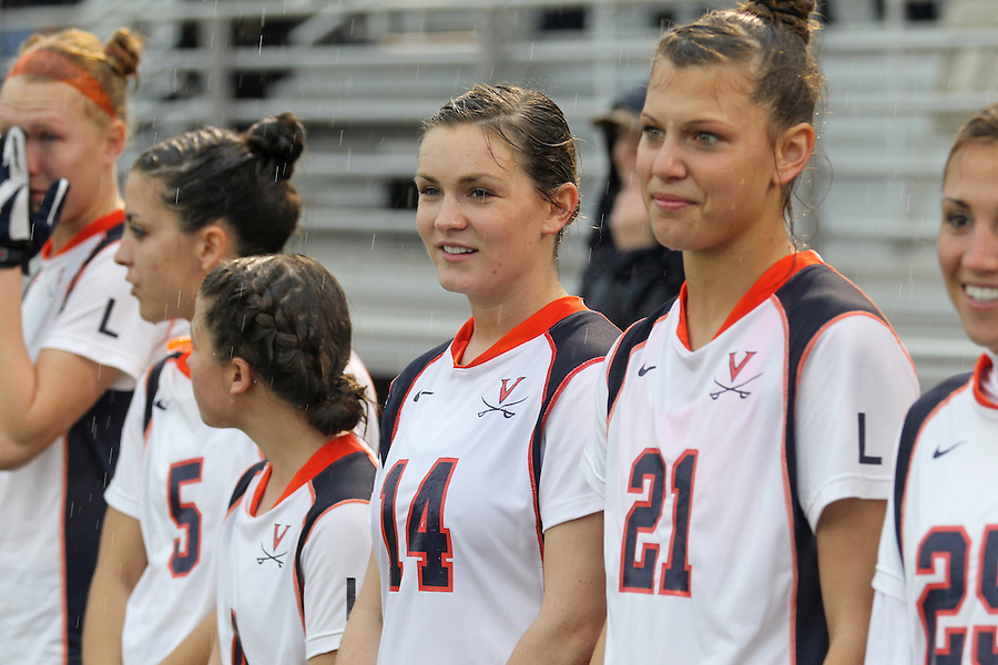 March 06, 2011 - Charlottesville, Virginia, USA -  The University of Virginia women's lacrosse player Caity Whiteley, 2nd from right, former roommate of Yeardley Love, looks on during a ceremony permanently retiring the number one jersey worn by Yeardley Love in honor and remembrance of her life Sunday at Klockner Stadium. Love's body was found May 3, 2010 and Virginia men's lacrosse player George Huguely is charged with murder. (Credit Image: © Andrew Shurtleff)
