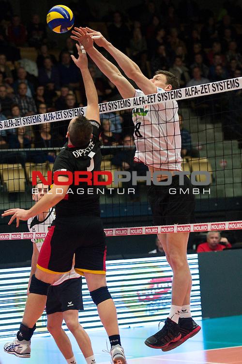 29.12.2013, Lotto Dome, Maaseik<br /> Volleyball, Belgien vs. Deutschland<br /> <br /> Frank Depestele (#5 BEL) - Block Marcus B&ouml;hme / Boehme (#8 GER)<br /> <br />   Foto &copy; nordphoto / Kurth