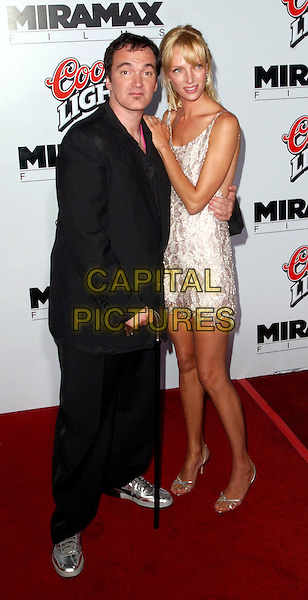 QUENTIN TARANTINO & UMA THURMAN.Kill Bill L.A. Premiere, Graumann's Chinese Theatre.full length, full-length, white silver patterend minidress, silver strappy sandals, walking stick, cane.www.capitalpictures.com.sales@capitalpictures.com.©Capital Pictures.