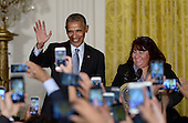 United States President Barack Obama (L) and Roxane Giron arrive on stage at a reception for Hispanic Heritage Month in the East Room of the White House on October 12, 2016 in Washington, DC. <br /> Credit: Olivier Douliery / Pool via CNP